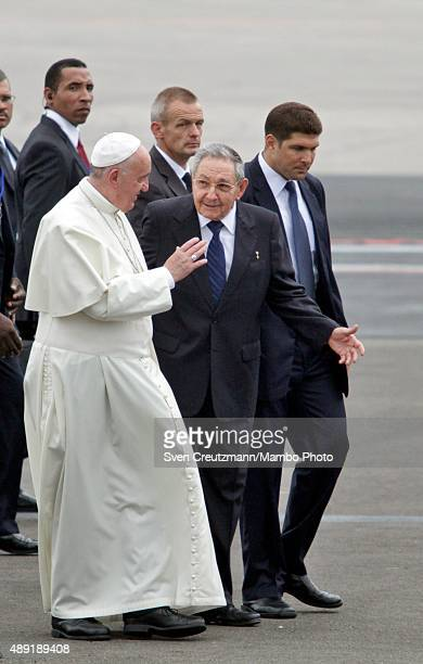 Pope Francis and Cuba's President Raul Castro walk at the end of the welcome ceremony upon the Pope's arrival at the Jose Marti airport for a...