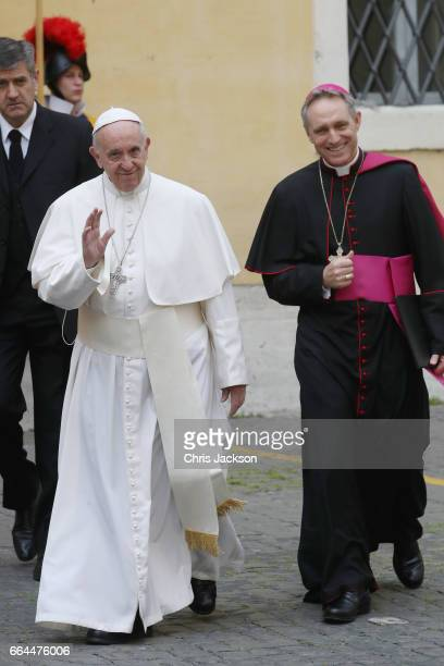 Pope Francis and his personal secretary Georg Gaenswein arrive for the meeting with Prince Charles Prince of Wales and Camilla Duchess of Cornwall on...