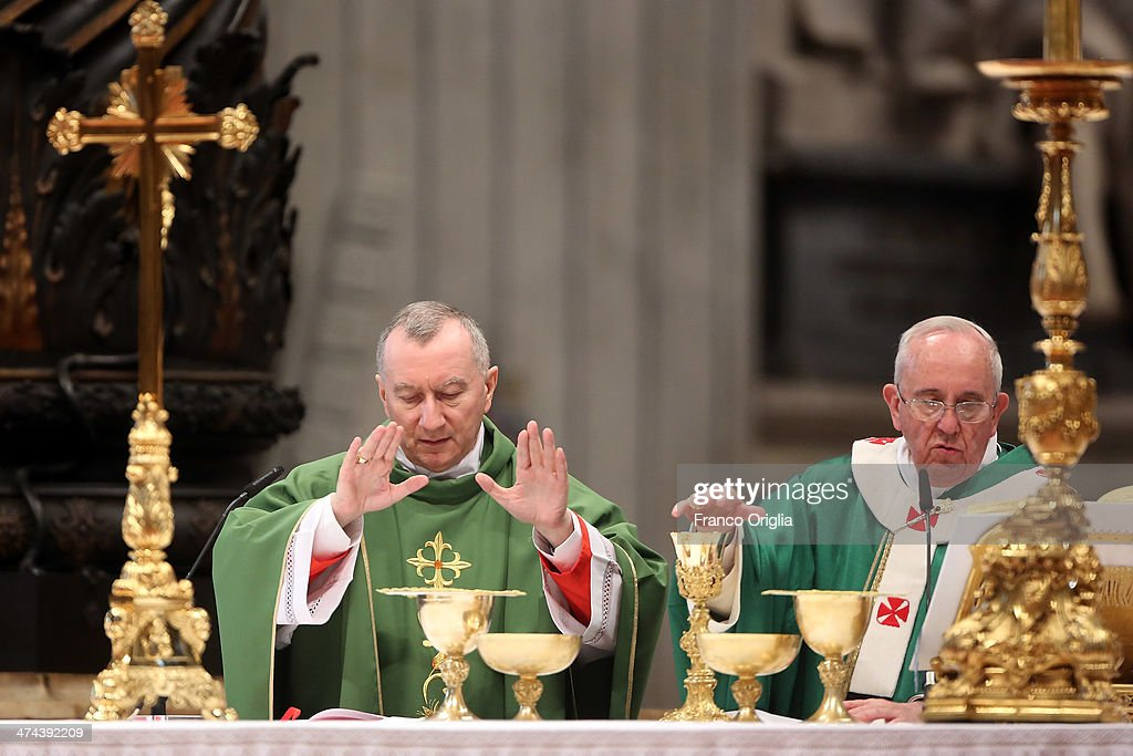 Pope Francis and new Cardinal Pietro Parolin, Vatican Secretary of State, attend a mass with newly appointed cardinals at St Peter's Basilica on February 23, 2014 in Vatican City, Vatican. Pope Francis presided over Mass in Saint Peter's Basilica on Sunday, one day after 19 bishops were added to the college of cardinals.