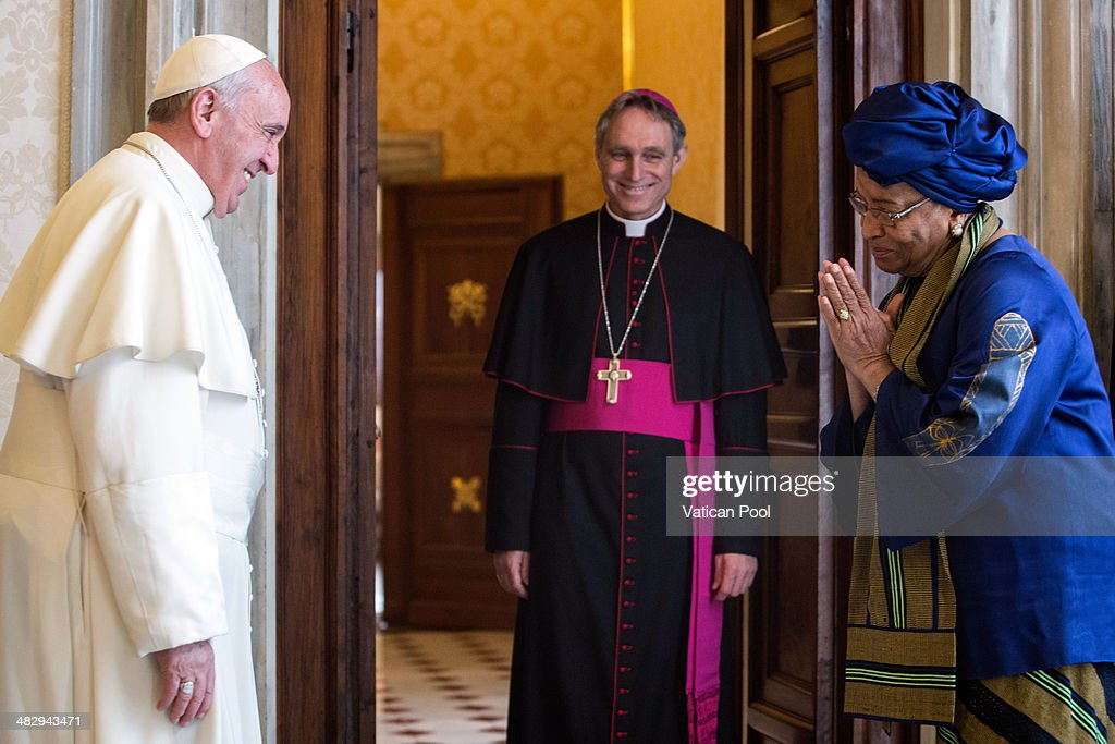 Pope Francis and Prefect of the Pontifical House and former personal secretary of Pope Benedict XVI, Georg Ganswein, meet President of Liberia <a gi-track='captionPersonalityLinkClicked' href=/galleries/search?phrase=Ellen+Johnson+Sirleaf&family=editorial&specificpeople=547358 ng-click='$event.stopPropagation()'>Ellen Johnson Sirleaf</a> at the Pontiff's private library in the Apostolic Palace on April 5, 2014 in Vatican City, Vatican. During the cordial discussions, emphasis was placed on the good relations between the Holy See and Liberia, and satisfaction was expressed regarding the positive progress made in strengthening the country's democratic structures.