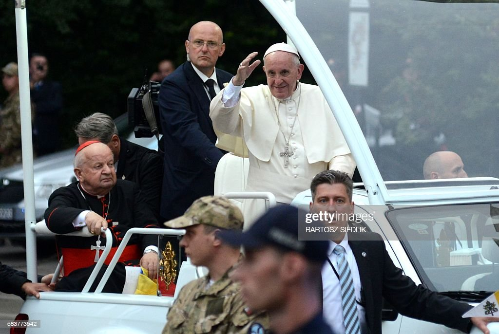 Pope Francis and Stanislaw Dziwisz Polish prelate of the Roman Catholic Church drive in popemobile to the Archibishops House in Krakow on July 27...