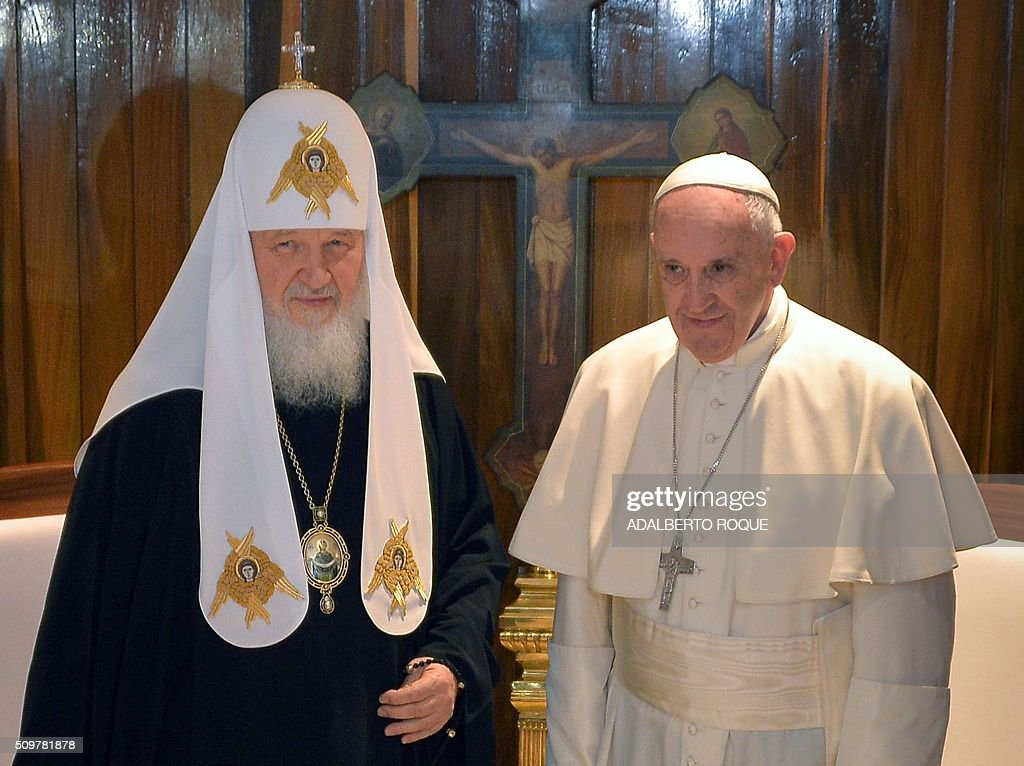 Pope Francis (R) and the head of the Russian Orthodox Church, Patriarch Kirill, are pictured during a historic meeting in Havana on February 12, 2016. Pope Francis and Russian Orthodox Patriarch Kirill kissed each other and sat down together Friday for the first meeting between their two branches of the church in nearly a thousand years. Francis, 79, in white robes and a skullcap and Kirill, 69, in black robes and a white headdress, exchanged kisses and embraced before sitting down smiling for the historic meeting at Havana airport. AFP PHOTO / ADALBERTO ROQUE / AFP / POOL / ADALBERTO ROQUE