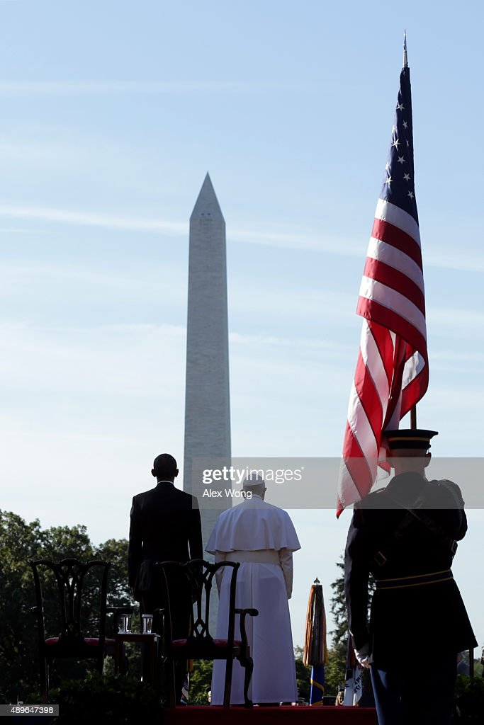 Pope Francis and US President Barack Obama stand for the national anthem of the Holy See during the arrival ceremony at the White House on September...