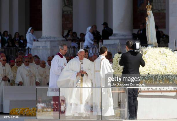 Pope Francis approaches a figure representing Our Lady Of Fatima during a mass at the Sanctuary of Fatima on May 13 2017 in Fatima Portugal Pope...