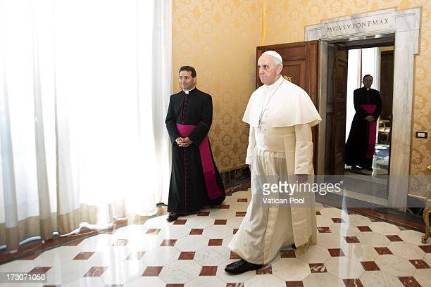 Pope Francis arrives at his private library to meet with President Anthony Carmona of Trinidad and Tobago on July 6 2013 in Vatican City Vatican