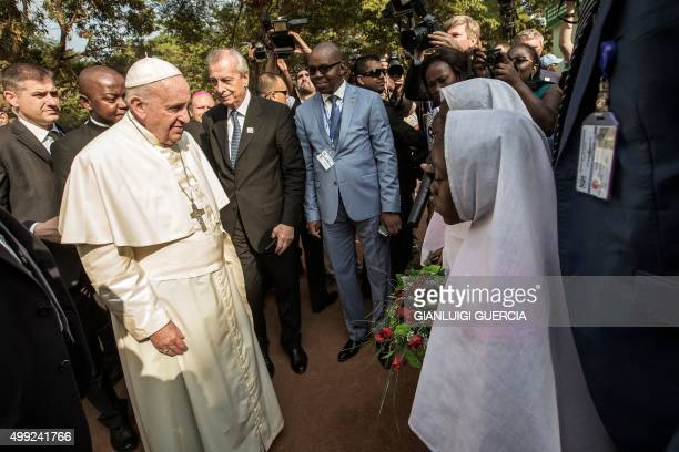 Pope Francis arrives at the Central Mosque in the PK5 neighborhood to meet with members of the Muslim community on November 30 2015 in Bangui Pope...