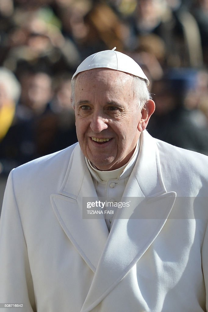 Pope Francis arrives for an audience to the Padre Pio Prayer Groups, on February 6, 2016 in Vatican. Pio was revered during his lifetime (1887-1968) and his popularity has continued to grow since his death, particularly in Italy, where mini-statues and pictures of the mystical Capuchin friar are ubiquitous. / AFP / TIZIANA FABI