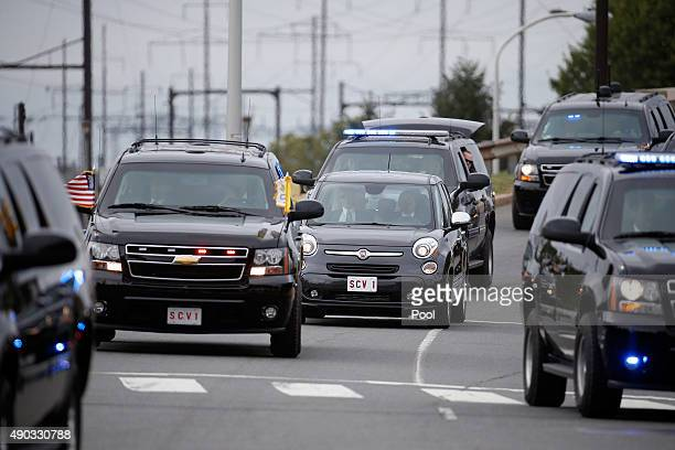 Pope Francis arrives in his Fiat 500 surrounded by a fleet of security vehicles September 27 2015 in Philadelphia Pennsylvania Pope Francis is in...