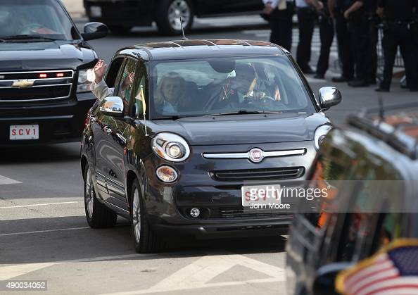 Pope Francis arrives in his Fiat to Lady Queen of Angels school on September 25 2015 in the East Harlem neighborhood of New York City The pope...