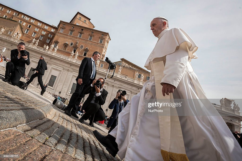 Pope Francis arrives to celebrate his Weekly General Audience in St. Peter's Square in Vatican City, Vatican on May 25, 2016. At the conclusion of his weekly General Audience, Pope Francis prayed for the victims of terrorist attacks that took place in Syria on Monday.