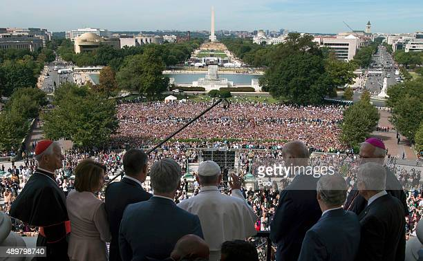 Pope Francis arrives with House and Senate leadership and local clergy on the balcony of the Speaker of the House after he delivered an address to a...