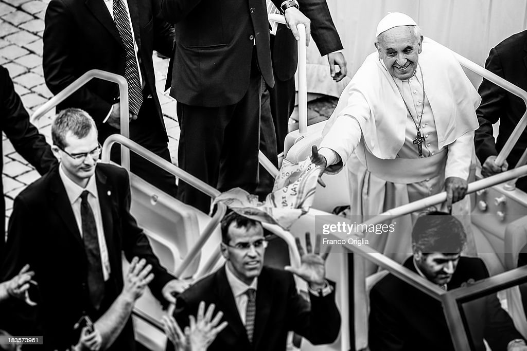 <a gi-track='captionPersonalityLinkClicked' href=/galleries/search?phrase=Pope+Francis&family=editorial&specificpeople=2499404 ng-click='$event.stopPropagation()'>Pope Francis</a> attends a mass on the occasion of the Day for Catechists in St. Peter's square on September 29, 2013 in Vatican City, Vatican. After the success of his Social networking accounts of Twitter and Facebook, <a gi-track='captionPersonalityLinkClicked' href=/galleries/search?phrase=Pope+Francis&family=editorial&specificpeople=2499404 ng-click='$event.stopPropagation()'>Pope Francis</a> joined Instagram, reporting today more than 8000 followers.
