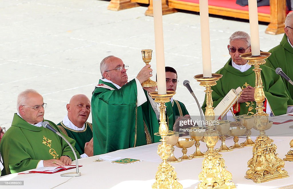 <a gi-track='captionPersonalityLinkClicked' href=/galleries/search?phrase=Pope+Francis&family=editorial&specificpeople=2499404 ng-click='$event.stopPropagation()'>Pope Francis</a> attends a mass on the occasion of the Marian Day on October 13, 2013 in Vatican City, Vatican. <a gi-track='captionPersonalityLinkClicked' href=/galleries/search?phrase=Pope+Francis&family=editorial&specificpeople=2499404 ng-click='$event.stopPropagation()'>Pope Francis</a> consecrated the world to the Immaculate Heart of Mary as part of Marian Day celebrations that will involve the statue of Our Lady of Fatima. The statue is normally kept in the Shrine of Fatima in Portugal but is in Rome this weekend for the consecration which is one of the highlights of the ongoing Year of Faith.
