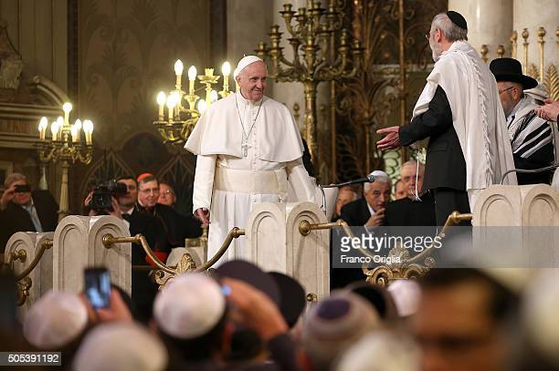 Pope Francis attends a visit to the Rome's synagogue on January 17 2016 in Rome Italy The visit marks the third time a pontiff has been invited to...