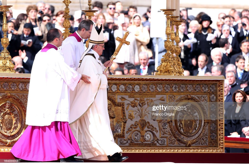 <a gi-track='captionPersonalityLinkClicked' href=/galleries/search?phrase=Pope+Francis&family=editorial&specificpeople=2499404 ng-click='$event.stopPropagation()'>Pope Francis</a> attends his Inauguration Mass in St Peter's Square on March 19, 2013 in Vatican City, Vatican. The inauguration of <a gi-track='captionPersonalityLinkClicked' href=/galleries/search?phrase=Pope+Francis&family=editorial&specificpeople=2499404 ng-click='$event.stopPropagation()'>Pope Francis</a> is being held in front of an expected crowd of up to one million pilgrims and faithful who have crowded into St Peter's Square and the surrounding streets to see the former Cardinal of Buenos Aires officially take up his position. <a gi-track='captionPersonalityLinkClicked' href=/galleries/search?phrase=Pope+Francis&family=editorial&specificpeople=2499404 ng-click='$event.stopPropagation()'>Pope Francis</a>' inauguration takes place in front his cardinals, spiritual leaders as well as heads of states from around the world and he will now lead an estimated 1.3 billion Catholics.
