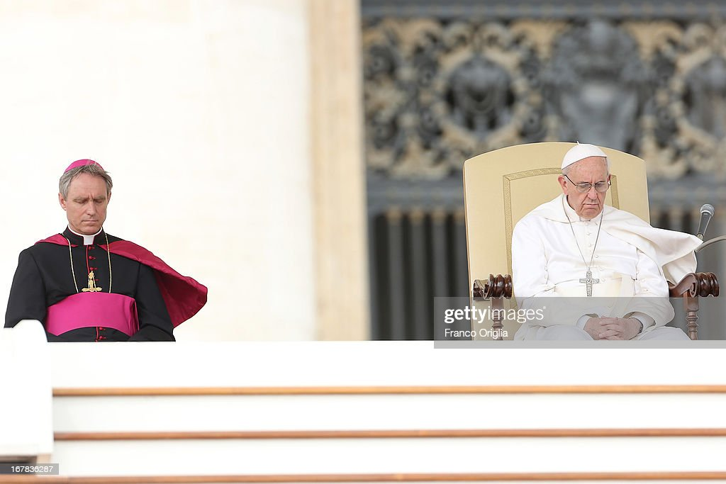 <a gi-track='captionPersonalityLinkClicked' href=/galleries/search?phrase=Pope+Francis&family=editorial&specificpeople=2499404 ng-click='$event.stopPropagation()'>Pope Francis</a> attends his Weekly Audience in St. Peter's Square on May 1, 2013 in Vatican City, Vatican. Marking the feast of St Joseph the Worker and World Labor Day today, the Pontiff launched an urgent appeal to Christians and men and women of goodwill worldwide to take decisive steps to end slave labor.