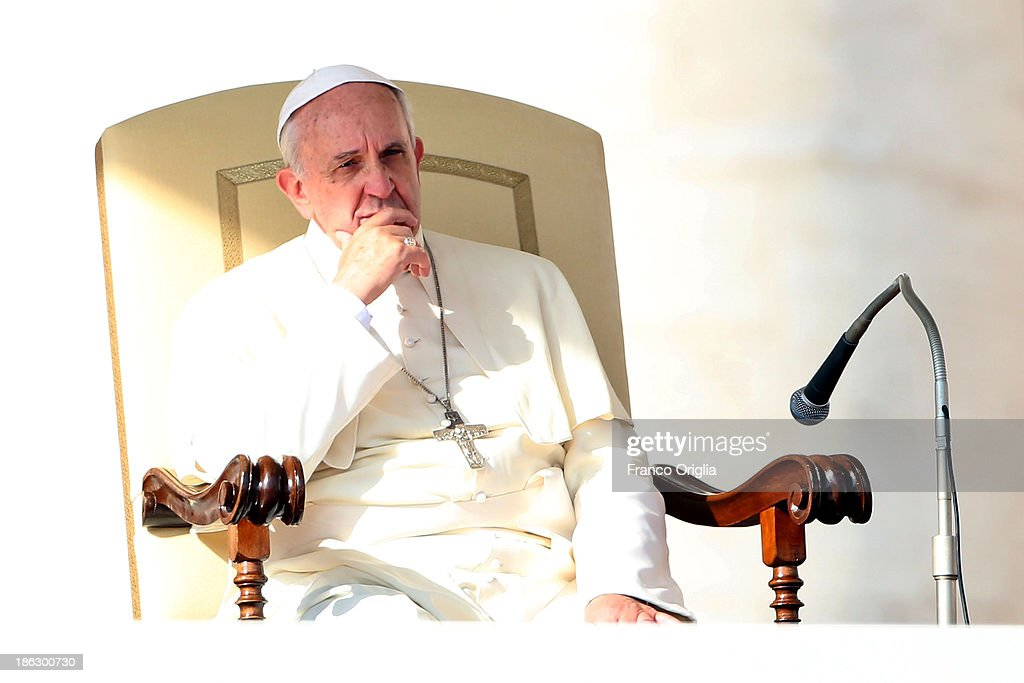 <a gi-track='captionPersonalityLinkClicked' href=/galleries/search?phrase=Pope+Francis&family=editorial&specificpeople=2499404 ng-click='$event.stopPropagation()'>Pope Francis</a> attends his weekly General Audience at St. Peter's Square on October 30, 2013 in Rome, Italy. During the audience the pontiff continued his series of catechetical reflections on the Creed, focusing this week on the Communion of Saints.