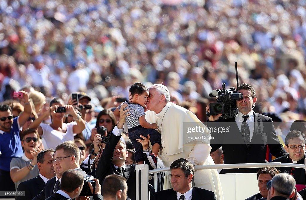 <a gi-track='captionPersonalityLinkClicked' href=/galleries/search?phrase=Pope+Francis&family=editorial&specificpeople=2499404 ng-click='$event.stopPropagation()'>Pope Francis</a> attends his weekly General Audience in St. Peter's Square on September 18, 2013 in Vatican City, Vatican. Pontiff called on Catholics together with other Christians to continue to pray for peace in the most trouble parts of the world.