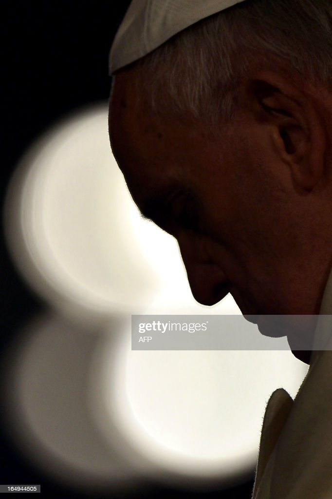 Pope Francis attends the celebration of the Way of the Cross on Good Friday on March 29, 2013 at the Colosseum in Rome. Pope Francis presided over his first Good Friday which will culminate in a torch-lit procession at Rome's Colosseum and prayers for peace in a Middle East 'torn apart by injustice and conflicts'.