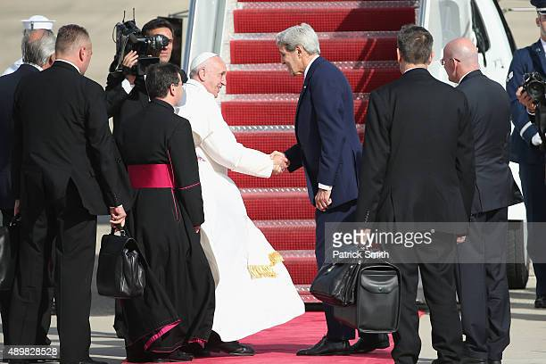 Pope Francis bids farewell to Secretary of State John Kerry as he departs from Washington DC en route to New York City on September 24 2015 in Joint...