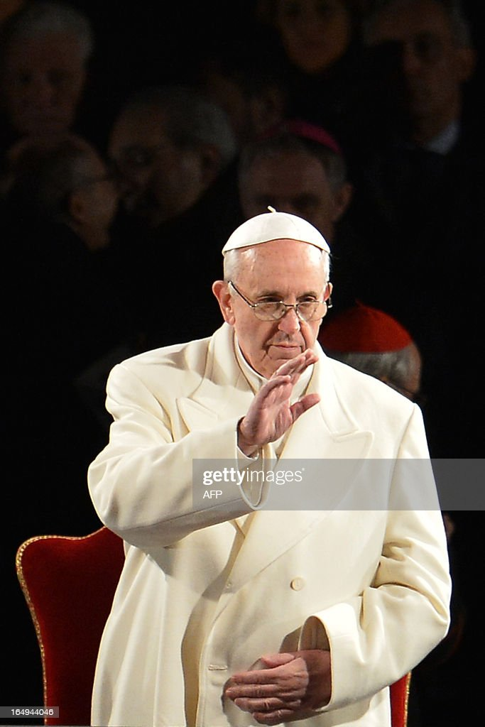 Pope Francis blesses faithful during the Way of the Cross on Good Friday on March 29, 2013 at the Colosseum in Rome. Pope Francis presided over his first Good Friday which will culminate in a torch-lit procession at Rome's Colosseum and prayers for peace in a Middle East 'torn apart by injustice and conflicts'.
