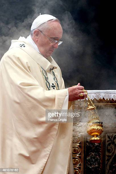 Pope Francis blesses the alter with incense during the Epiphany Mass at St Peter's Basilica on January 6 2015 in Vatican City Vatican During his...