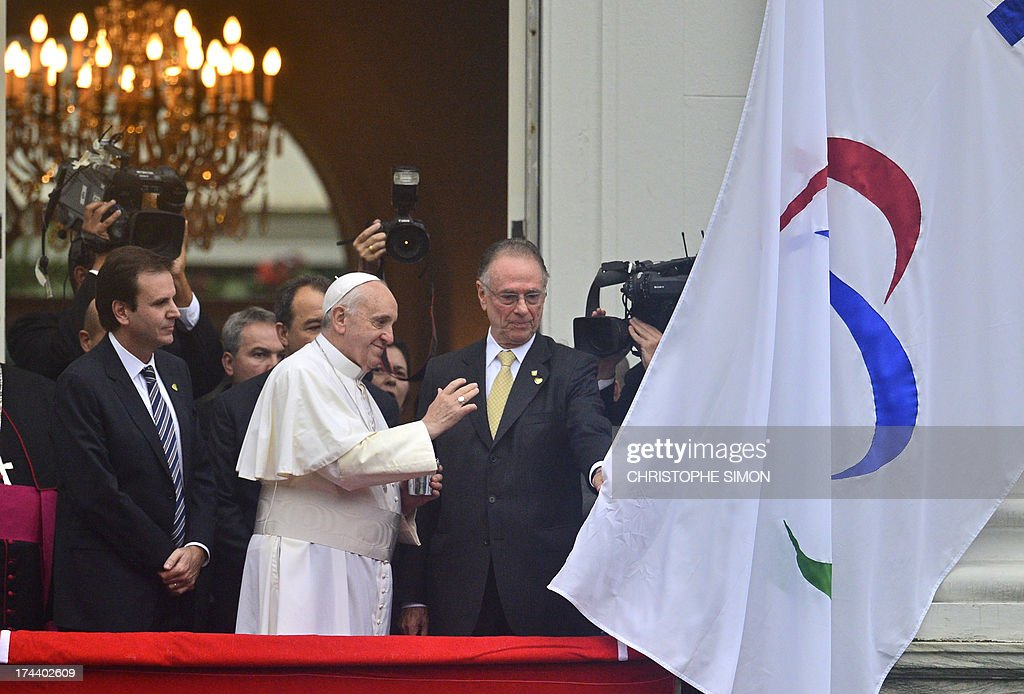 Pope Francis blesses the Rio 2016 Olympic flag ahead of the 2016 Summer Games, at the City Palace in Rio de Janeiro where he will also receive the keys of the city, on July 25, 2013. The first Latin American and Jesuit pontiff arrived in Brazil mainly for the huge five-day Catholic gathering World Youth Day. At left, Rio de Janeiro's Mayor Eduardo Paes and at right, the president of the Brazilian Olympic Committee, Carlos Arthur Nuzman.