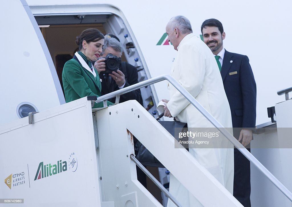 Pope Francis boards a plane to Cuba, where he is scheduled to meet Russian Orthodox Patriarch Kirill, before to continue for a week-long trip to Mexico, at Rome's Fiumicino international airport on 12 February 2016.