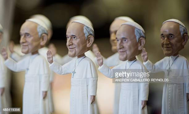 Pope Francis bobble heads are displayed at a souvenir store in Washington DC on August 27 2015 Pope Francis will travel to the United States from...