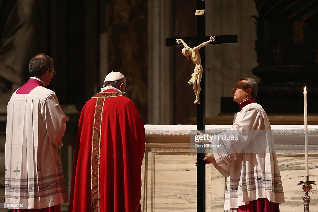 <a gi-track='captionPersonalityLinkClicked' href=/galleries/search?phrase=Pope+Francis&family=editorial&specificpeople=2499404 ng-click='$event.stopPropagation()'>Pope Francis</a> bows his head in front of a crucifix during a Papal Mass with the Celebration of the Lord's Passion inside St Peter's Basilica on March 29, 2013 in Vatican City, Vatican. <a gi-track='captionPersonalityLinkClicked' href=/galleries/search?phrase=Pope+Francis&family=editorial&specificpeople=2499404 ng-click='$event.stopPropagation()'>Pope Francis</a> is taking part in his first holy week as pontiff and will later today preside over the Way Of the Cross procession at the Colosseum in Rome.
