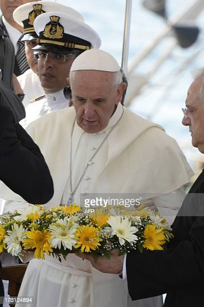 Pope Francis casts a wreath into the sea off Lampedusa island a key destination of tens of thousands of wouldbe immigrants from Africa during his...