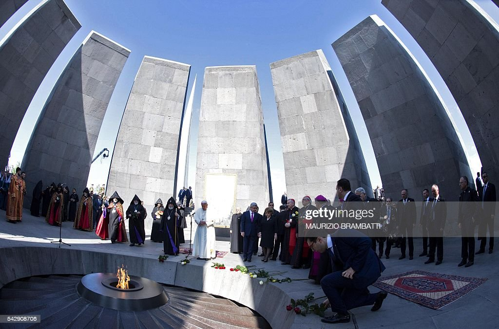 Pope Francis, Catholicos of All Armenians Karekin II and Armenian President Serzh Sarkisian attend a ceremony in commemoration of Armenians killed by Ottoman forces during World War I at the Tsitsernakaberd Genocide Memorial in Yerevan on June 25, 2016. / AFP / POOL / MAURIZIO