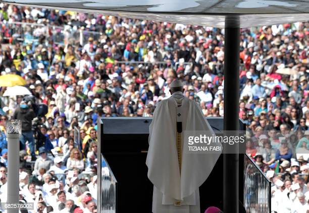 Pope Francis celebrates a centenary mass marking the apparition of the Virgin Mary at Fatima's Sanctuary central Portugal on May 13 2017 Two of the...