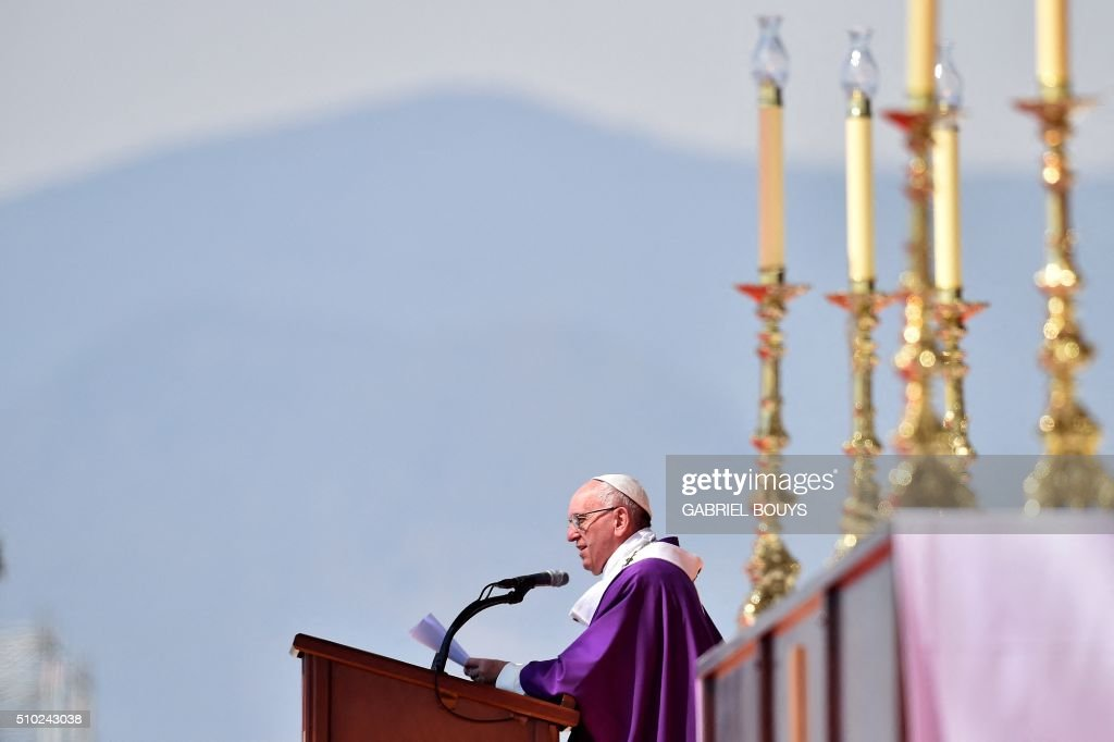 Pope Francis celebrates an open-air mass in Ecatepec --a rough, crime-plagued Mexico City suburb-- on February 14, 2016. Pope Francis has chosen to visit some of Mexico's most troubled regions during his five-day trip to the world's second most populous Catholic country. AFP PHOTO/GABRIEL BOUYS / AFP / GABRIEL BOUYS