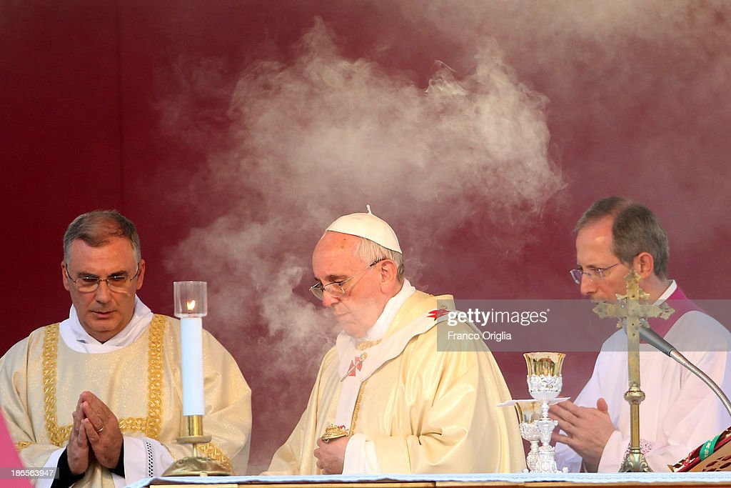 <a gi-track='captionPersonalityLinkClicked' href=/galleries/search?phrase=Pope+Francis&family=editorial&specificpeople=2499404 ng-click='$event.stopPropagation()'>Pope Francis</a> celebrates mass for the solemnity of all Saints at the Monumental Cemetery of Verano on November 1, 2013 in Rome, Italy. The Pontiff celebrated Mass on Friday to mark the solemnity of all Saints, after which he prayed for the migrants who died in the desert or drowned at sea this month. The Mass was celebrated at the entrance of the Verano cemetery in Rome and took place exactly 20 years after the last papal visit there.