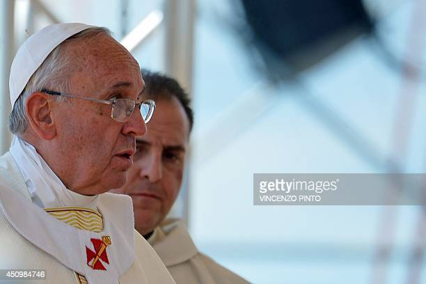 Pope Francis celebrates mass in Sibari in the southern Italian region of Calabria at the end of his oneday visit in the city on June 21 2014 Pope...