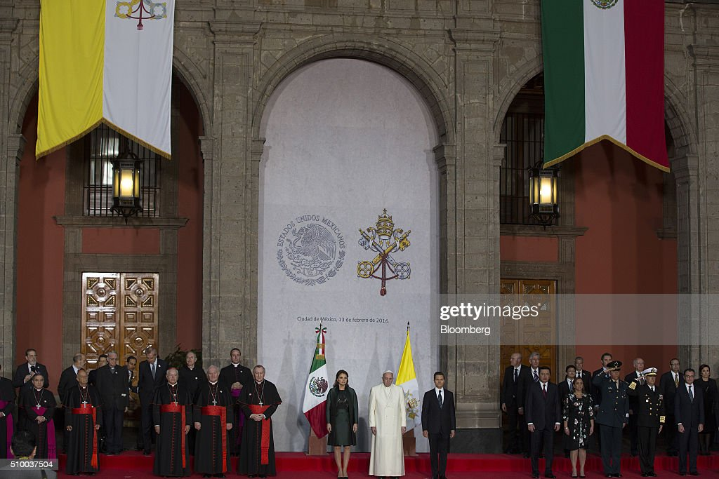 Pope Francis, center, Enrique Pena Nieto, Mexico's president, center right, and Pena Nieto's wife, Angelica Rivera, center left, stand during the welcoming ceremony at The National Palace in Mexico City, Mexico on Saturday, Feb. 13, 2016. Pope Francis is scheduled to celebrate mass at the Basilica of Guadalupe on Saturday night during his trip to Mexico which runs through Wednesday. Photographer: Susana Gonzalez/Bloomberg via Getty Images
