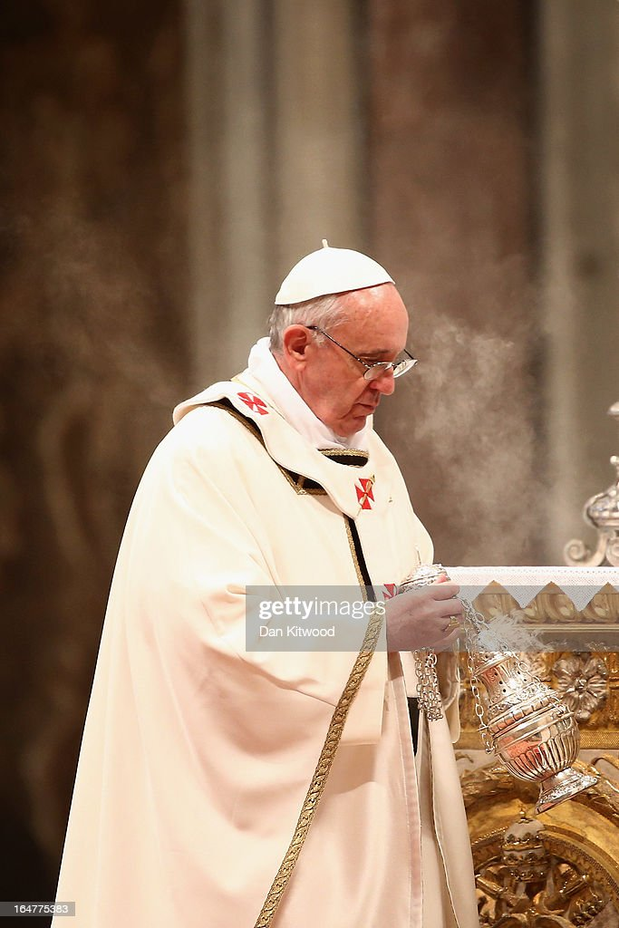 <a gi-track='captionPersonalityLinkClicked' href=/galleries/search?phrase=Pope+Francis&family=editorial&specificpeople=2499404 ng-click='$event.stopPropagation()'>Pope Francis</a> conducts his first Chrism Mass inside St Peter's Basilica on the morning of Holy Thursday on March 28, 2013 in Vatican City, Vatican. Newly-appointed <a gi-track='captionPersonalityLinkClicked' href=/galleries/search?phrase=Pope+Francis&family=editorial&specificpeople=2499404 ng-click='$event.stopPropagation()'>Pope Francis</a> has begun the Christian traditions leading up to Easter during his first holy week as pontiff. <a gi-track='captionPersonalityLinkClicked' href=/galleries/search?phrase=Pope+Francis&family=editorial&specificpeople=2499404 ng-click='$event.stopPropagation()'>Pope Francis</a> will today hold a feet-washing mass, which commemorates the last supper, at a youth detention centre where he will wash the feet of prisoners.