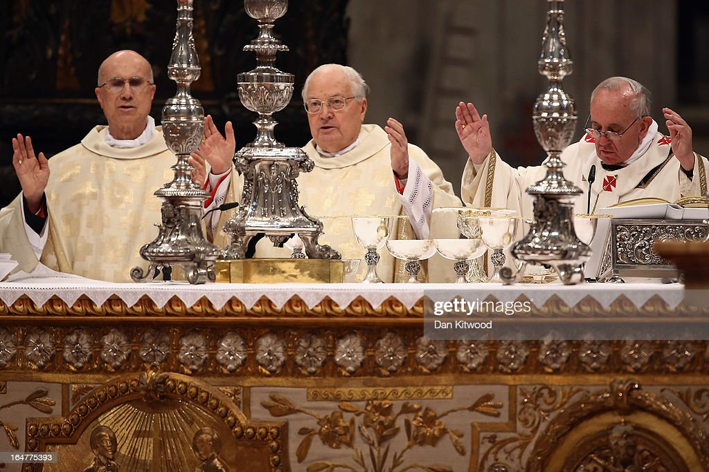 <a gi-track='captionPersonalityLinkClicked' href=/galleries/search?phrase=Pope+Francis&family=editorial&specificpeople=2499404 ng-click='$event.stopPropagation()'>Pope Francis</a> (R) conducts his first Chrism Mass inside St Peter's Basilica on the morning of Holy Thursday on March 28, 2013 in Vatican City, Vatican. Newly-appointed <a gi-track='captionPersonalityLinkClicked' href=/galleries/search?phrase=Pope+Francis&family=editorial&specificpeople=2499404 ng-click='$event.stopPropagation()'>Pope Francis</a> has begun the Christian traditions leading up to Easter during his first holy week as pontiff. <a gi-track='captionPersonalityLinkClicked' href=/galleries/search?phrase=Pope+Francis&family=editorial&specificpeople=2499404 ng-click='$event.stopPropagation()'>Pope Francis</a> will today hold a feet-washing mass, which commemorates the last supper, at a youth detention centre where he will wash the feet of prisoners.