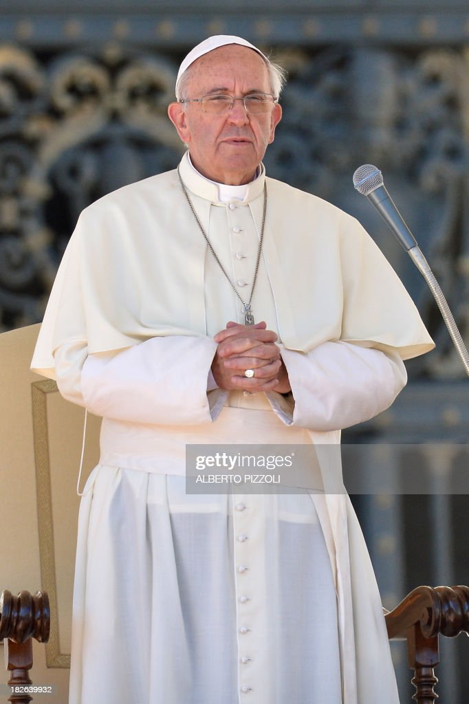 Pope Francis delivers a speech during his general audience at St Peter's square on September 25, 2013 at the Vatican. AFP PHOTO / ALBERTO PIZZOLI