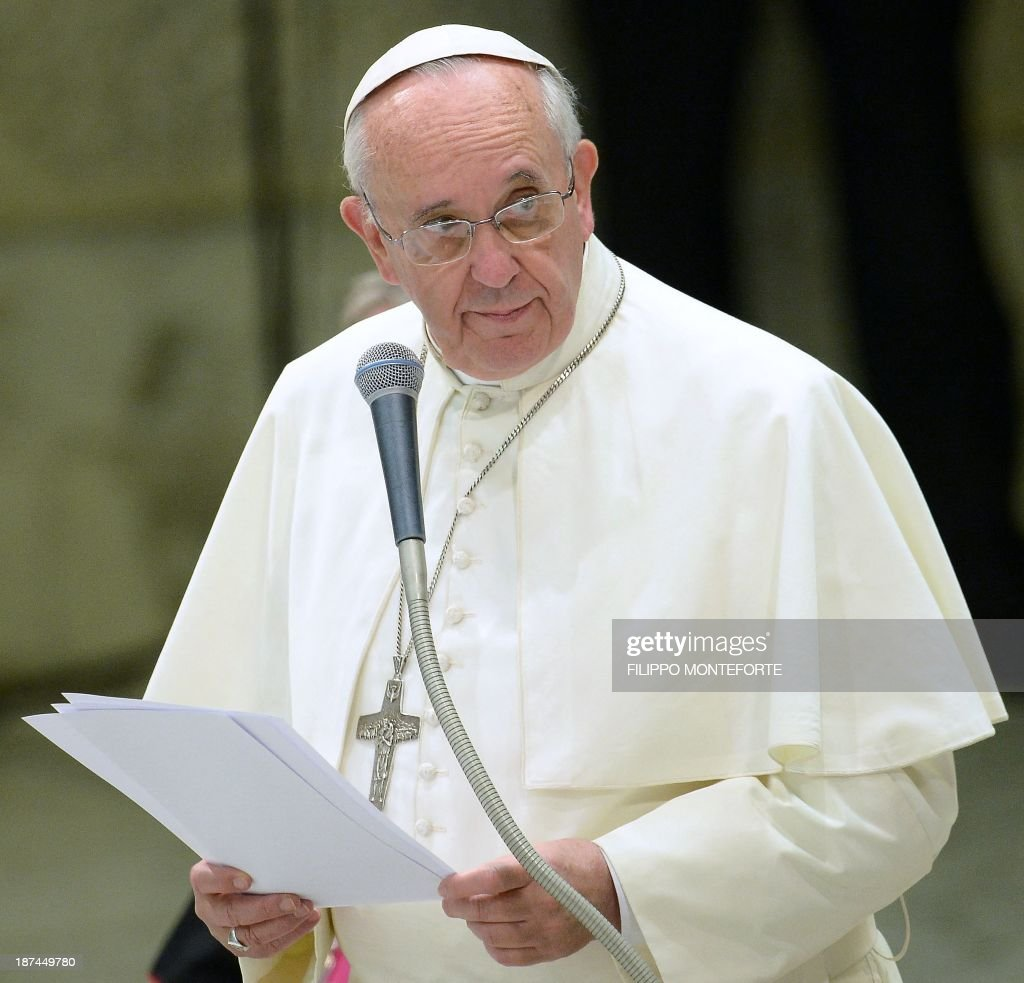 Pope Francis delivers a speech during his meeting with the Italian Union for the transportation of sick people to Lourdes and International Shrines (UNITALSI) on November 9, 2013 in the Paul VI hall at the Vatican. AFP PHOTO / FILIPPO MONTEFORTE