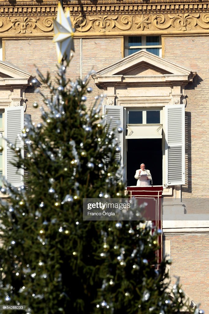 <a gi-track='captionPersonalityLinkClicked' href=/galleries/search?phrase=Pope+Francis&family=editorial&specificpeople=2499404 ng-click='$event.stopPropagation()'>Pope Francis</a> delivers his Angelus blessing from the window of his private studio to thousands of pilgrims gathered in Saint Peter's Square on December 8, 2013 in Vatican City, Vatican. <a gi-track='captionPersonalityLinkClicked' href=/galleries/search?phrase=Pope+Francis&family=editorial&specificpeople=2499404 ng-click='$event.stopPropagation()'>Pope Francis</a> on Friday paid tribute to Nelson Mandela expressing his hope that the late President's example will inspire generations of South Africans to put justice and common good at the forefront of their political aspirations.