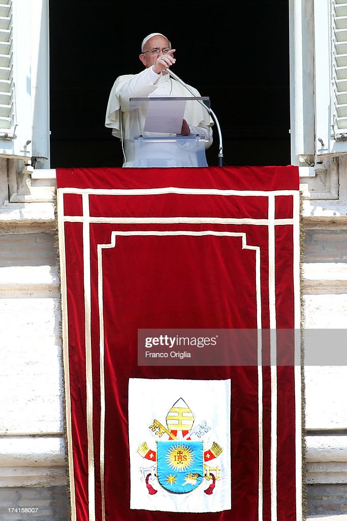 <a gi-track='captionPersonalityLinkClicked' href=/galleries/search?phrase=Pope+Francis&family=editorial&specificpeople=2499404 ng-click='$event.stopPropagation()'>Pope Francis</a> delivers his Angelus blessing to the pilgrims gathered in St Peter's Square on July 21, 2013 in Vatican City, Vatican. On the eve of his departure to Brazil for the World Youth Day celebrations in Rio de Janeiro, <a gi-track='captionPersonalityLinkClicked' href=/galleries/search?phrase=Pope+Francis&family=editorial&specificpeople=2499404 ng-click='$event.stopPropagation()'>Pope Francis</a> from the window of the apostolic palace asked those present in St Peter's Square to accompany him spiritually in prayer for this his first pastoral visit.