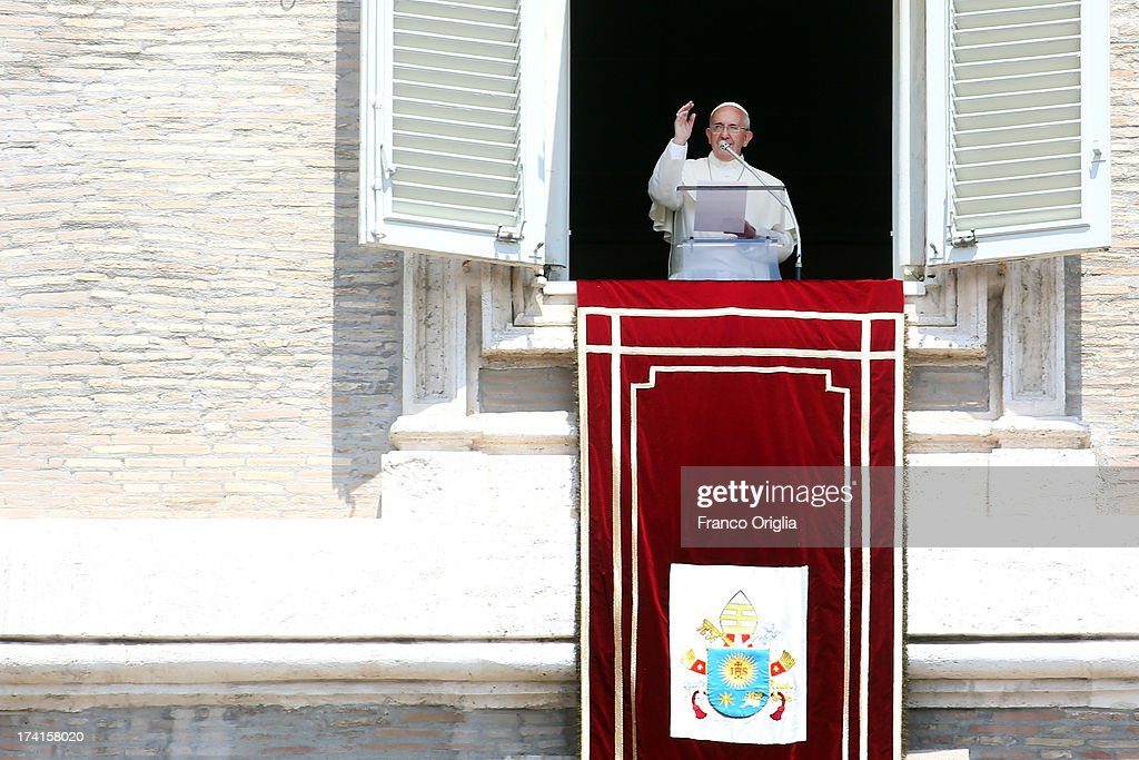 Pope Francis delivers his Angelus blessing to the pilgrims gathered in St Peter's Square on July 21, 2013 in Vatican City, Vatican. On the eve of his departure to Brazil for the World Youth Day celebrations in Rio de Janeiro, Pope Francis from the window of the apostolic palace asked those present in St Peter's Square to accompany him spiritually in prayer for this his first pastoral visit.