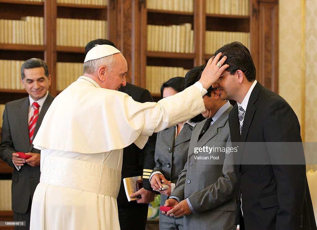 <a gi-track='captionPersonalityLinkClicked' href=/galleries/search?phrase=Pope+Francis&family=editorial&specificpeople=2499404 ng-click='$event.stopPropagation()'>Pope Francis</a> delivers his blessing to the Ecuador delegation accompaining President Rafael Correa at his private library on April 19, 2013 in Vatican City, Vatican. The President of Ecuador met <a gi-track='captionPersonalityLinkClicked' href=/galleries/search?phrase=Pope+Francis&family=editorial&specificpeople=2499404 ng-click='$event.stopPropagation()'>Pope Francis</a> for talks about his country and the church's contribution to aspects of Ecuador's social challenges that lie ahead.