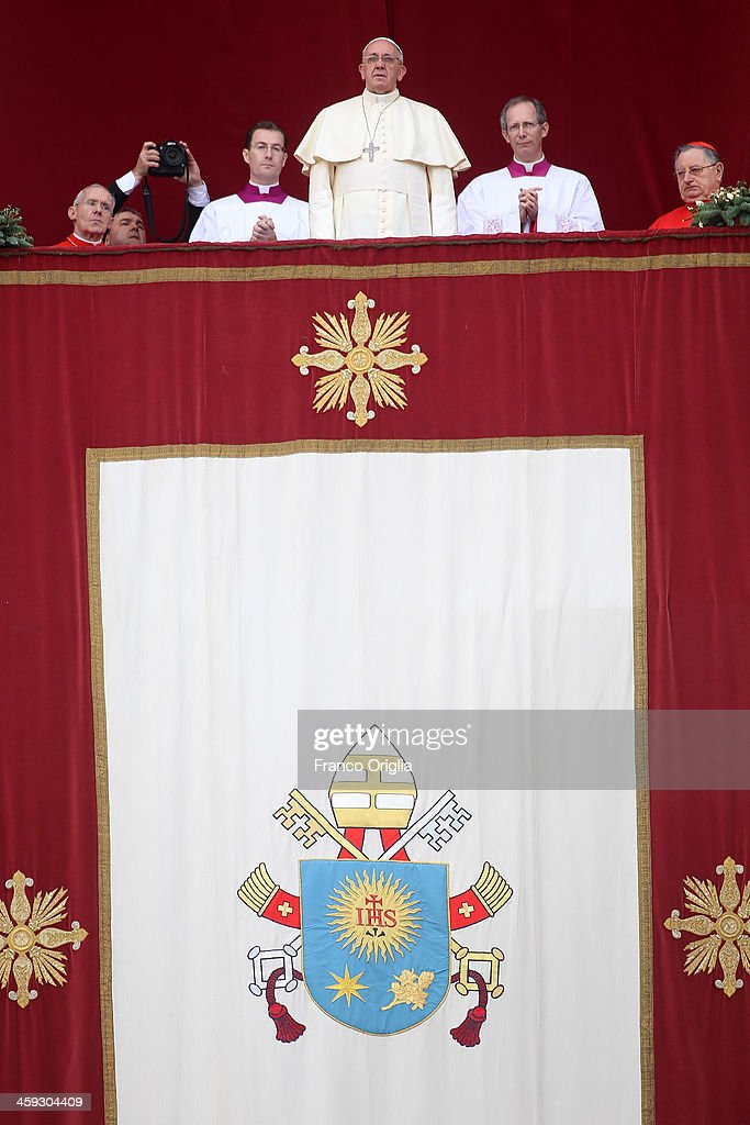 <a gi-track='captionPersonalityLinkClicked' href=/galleries/search?phrase=Pope+Francis&family=editorial&specificpeople=2499404 ng-click='$event.stopPropagation()'>Pope Francis</a> delivers his Christmas Day message from the central balcony of St Peter's Basilica on December 25, 2013 in Vatican City, Vatican. The 'Urbi et Orbi' blessing (to the city and to the world) is recognised as a Christmas tradition by Catholics with the <a gi-track='captionPersonalityLinkClicked' href=/galleries/search?phrase=Pope+Francis&family=editorial&specificpeople=2499404 ng-click='$event.stopPropagation()'>Pope Francis</a> focusing this year on the peace in the world.