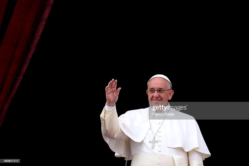 Pope Francis delivers his Christmas Day message from the central balcony of St Peter's Basilica on December 25, 2014 in Vatican City, Vatican. The 'Urbi et Orbi' blessing (to the city and to the world) is recognised as a Christmas tradition by Catholics with the Pope Francis focusing this year on the peace in the world.