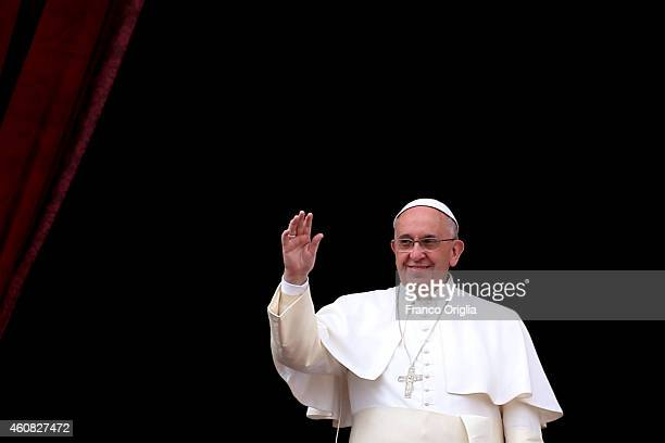 Pope Francis delivers his Christmas Day message from the central balcony of St Peter's Basilica on December 25 2014 in Vatican City Vatican The 'Urbi...