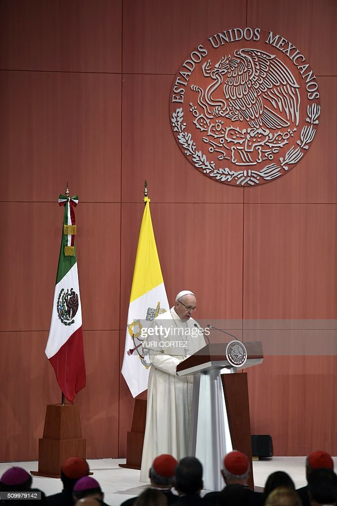 Pope Francis delivers his message at National Palace on February 13, 2016 in Mexico City. Francis became the first pope to enter Mexico's National Palace to meet President Enrique Pena Nieto, as he starts a cross-country tour that will highlight the country's violence and migration troubles. AFP PHOTO/ Yuri CORTEZ / AFP / YURI CORTEZ