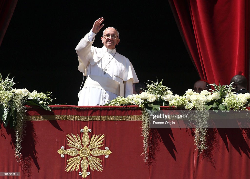 <a gi-track='captionPersonalityLinkClicked' href=/galleries/search?phrase=Pope+Francis&family=editorial&specificpeople=2499404 ng-click='$event.stopPropagation()'>Pope Francis</a> delivers his 'Urbi Et Orbi' blessing during Easter Mass in St. Peter's Square on April 20, 2014 in Vatican City, Vatican. The Holy Father delivered his Easter Day message 'Urbi et Orbi' blessing (to the city and to the world) from the central balcony of St Peter's Basilica, after the Easter Mass.